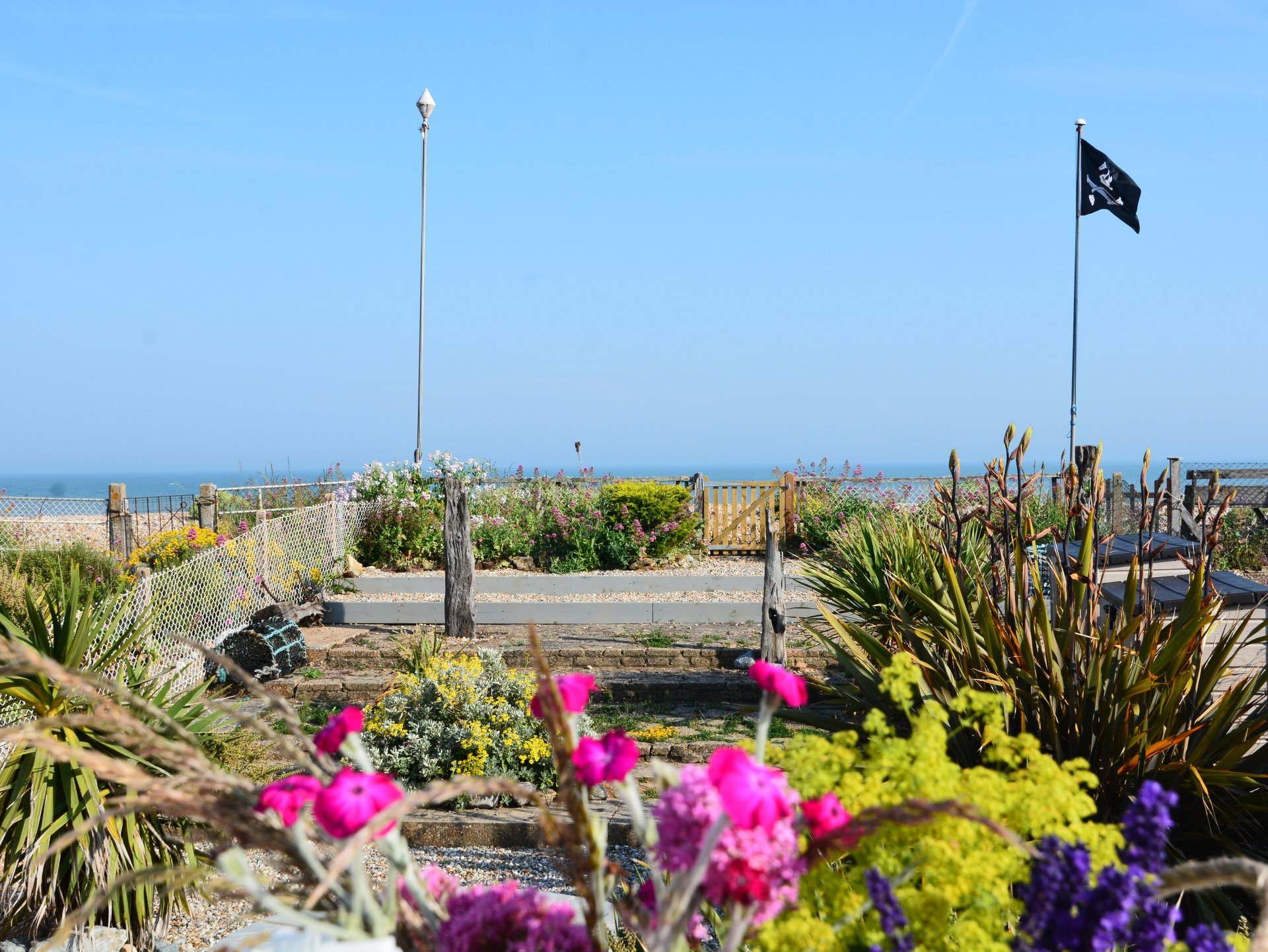 The Beach Hive, Pevensey Bay, Sussex Beach Fronted Holiday Cottage - Sleeps 6 - Views out to sea from the terrace