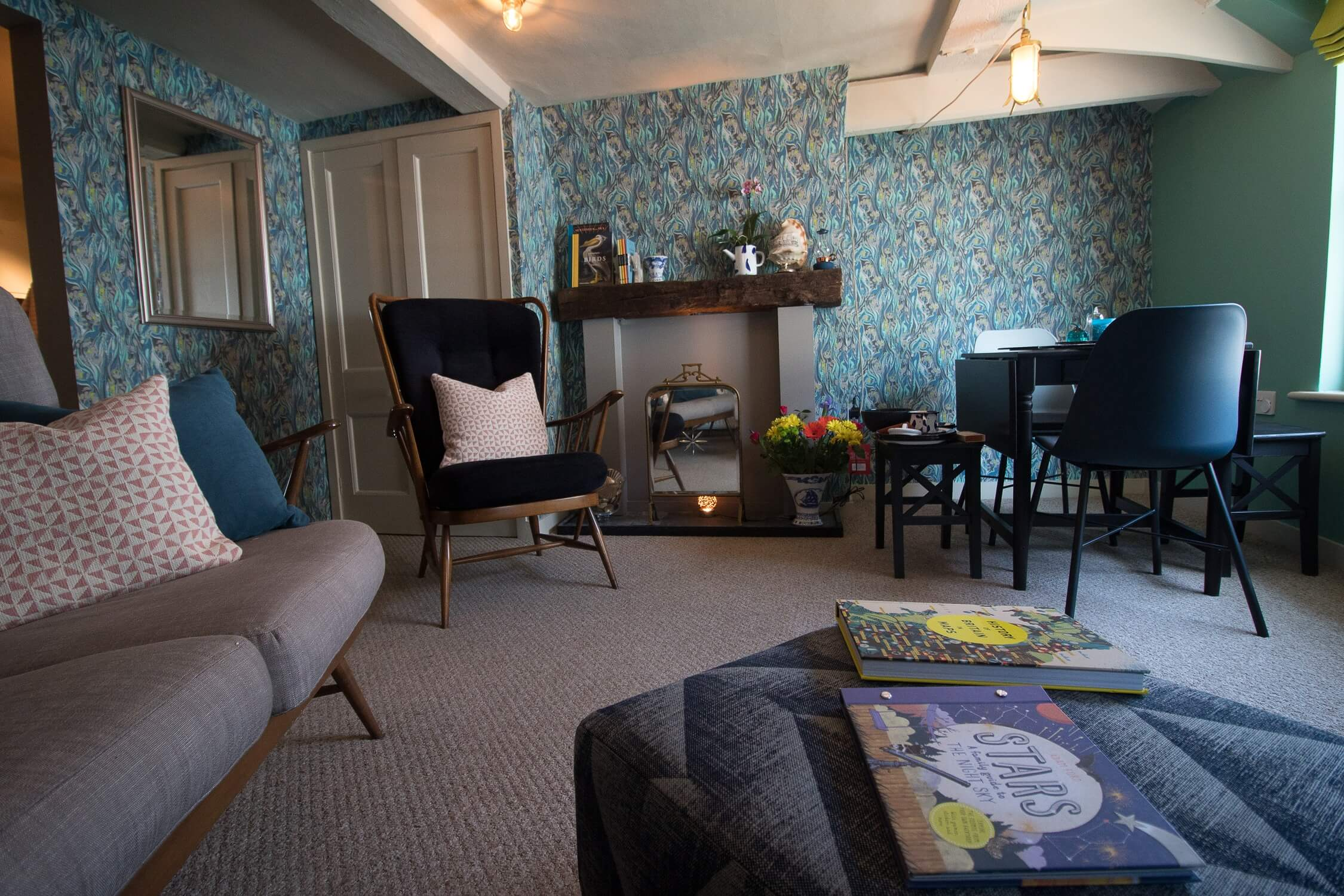 The Crow's Nest Rye - cosy sitting room with dining table for 4 people. Luxury self catering holiday home.