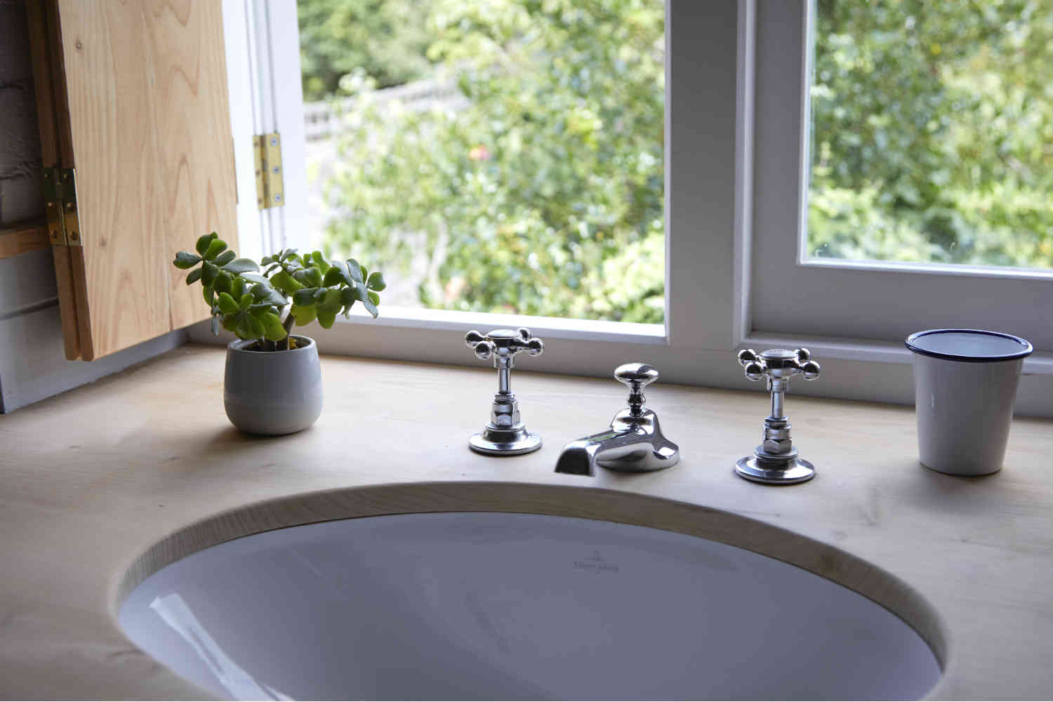 Bathroom sink overlooking pretty garden
