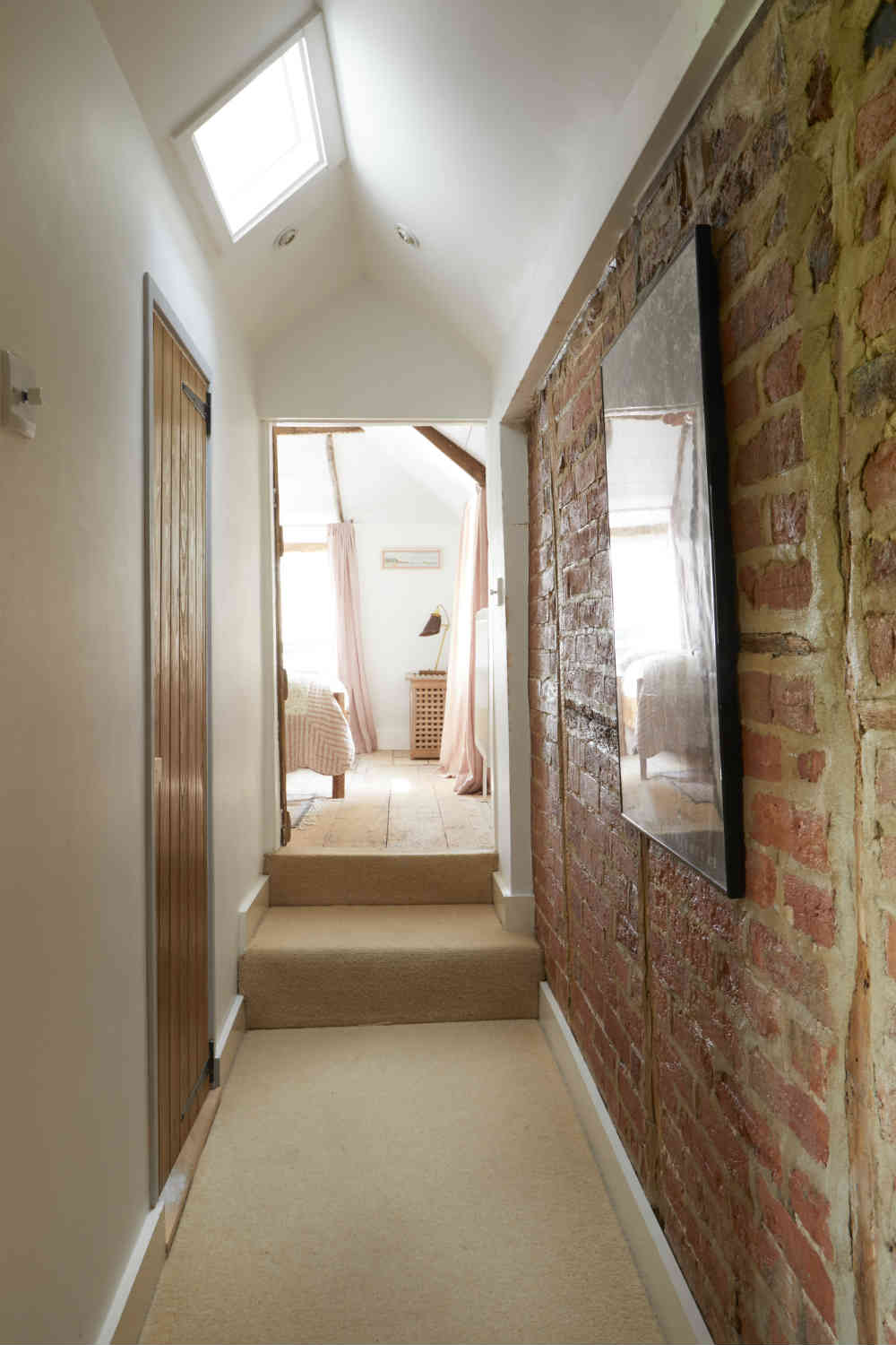 Exposed brick hallway