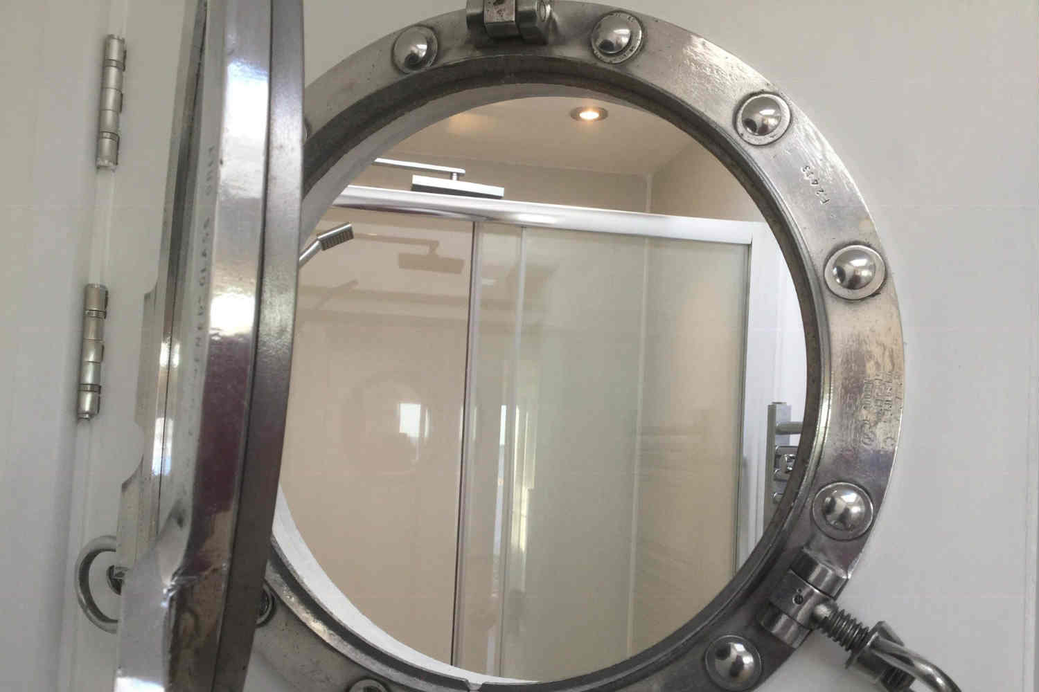 Porthole to allow sea views from the shower