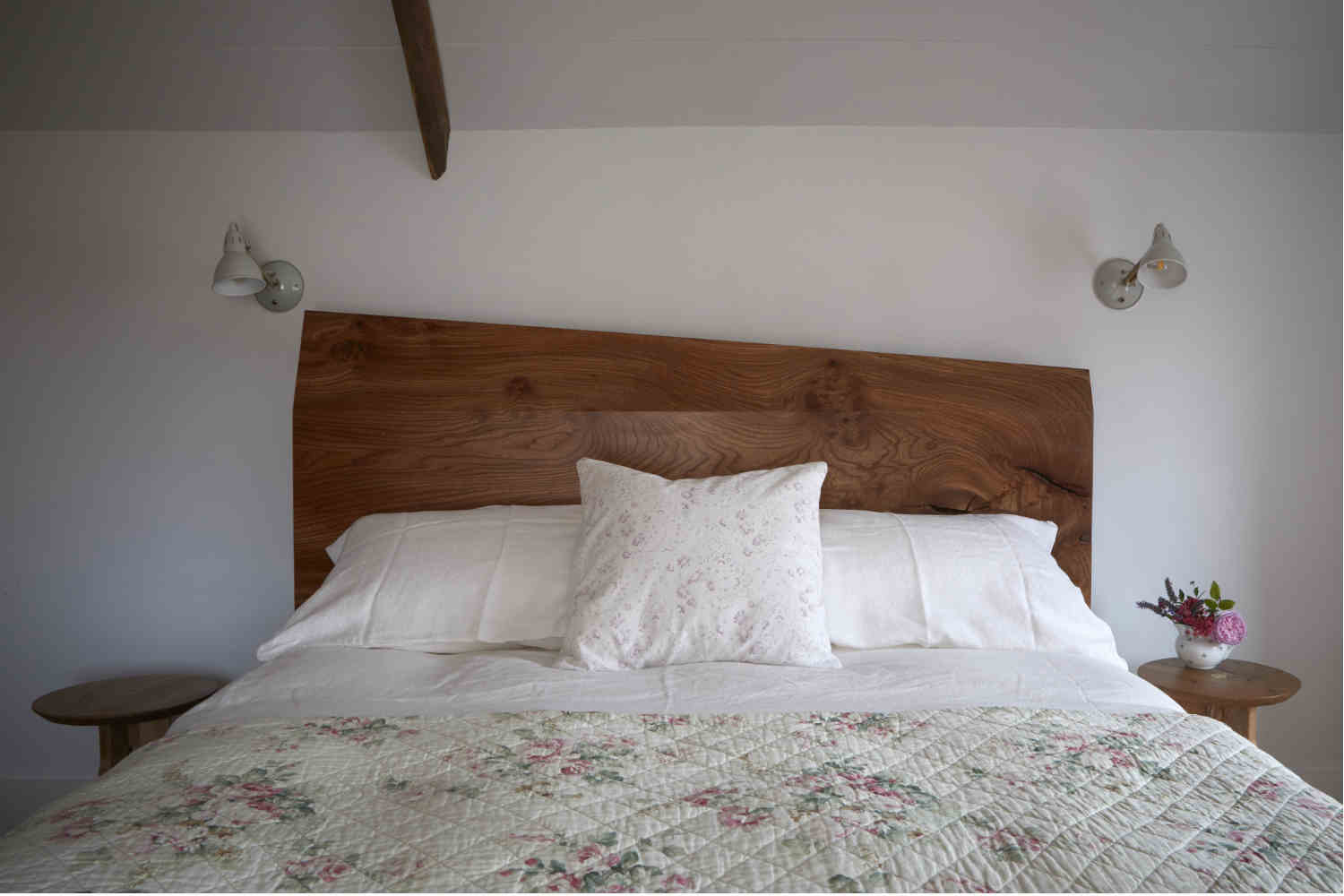 Pretty Elm bedroom with handmade headboard