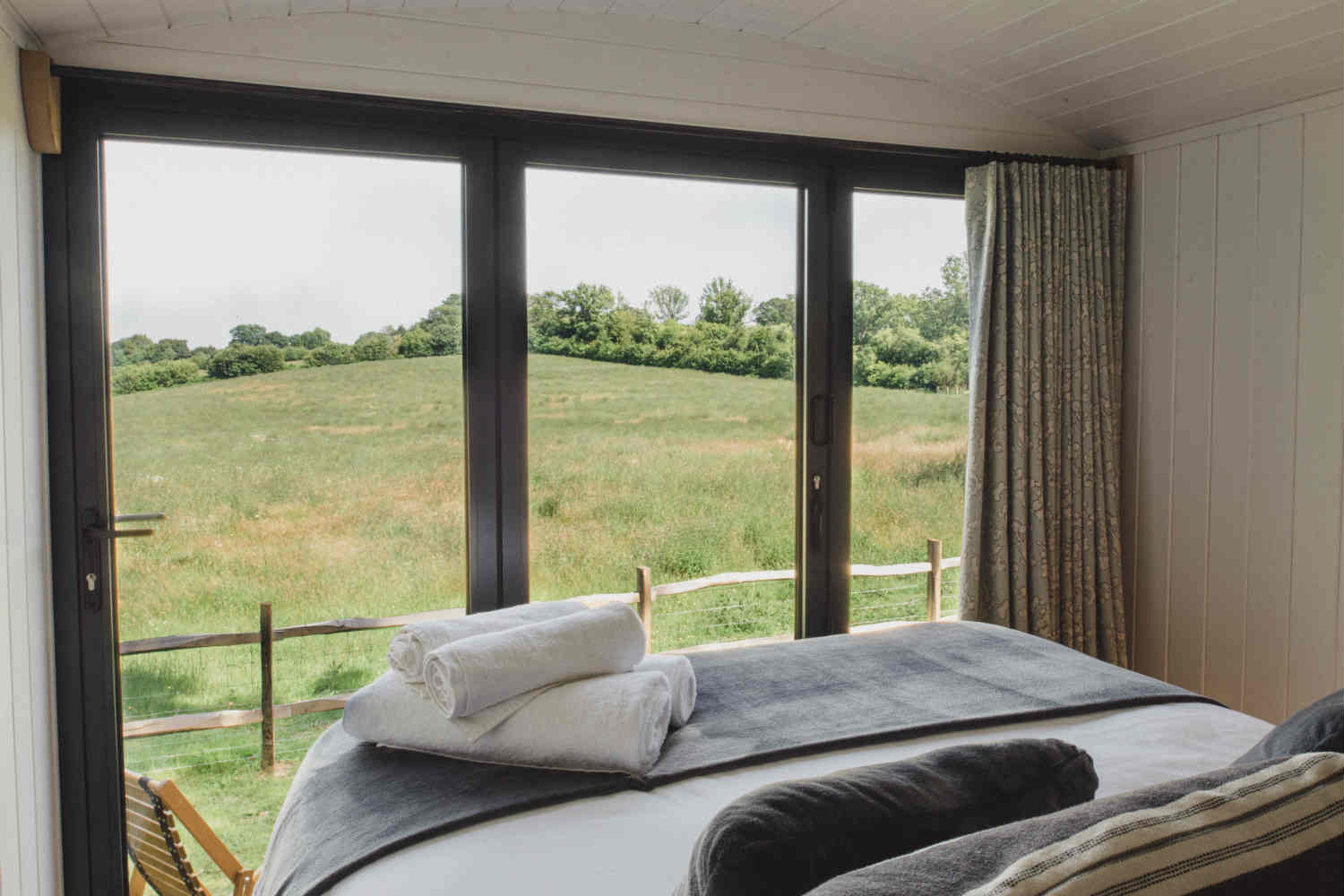 Soak in the views from bed