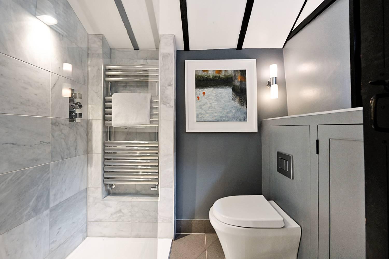 Walk in shower room with rainforest shower head