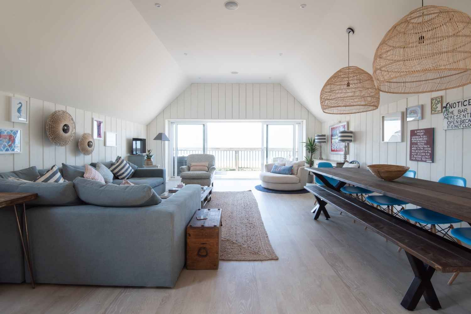 An open plan living space with views over the beach and sea