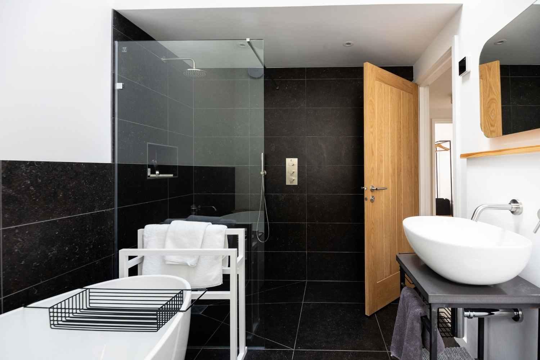 Bathroom 2 with bath and power shower