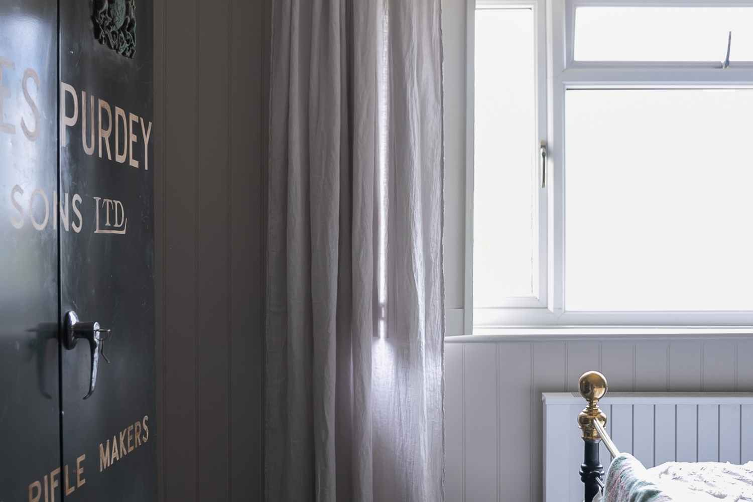 Bedroom Two - shutters and airy curtains