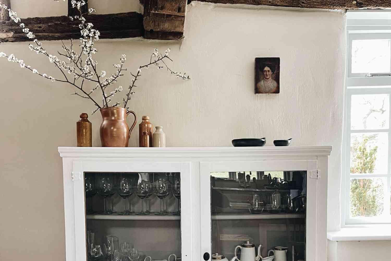 Kitchen cupboard, complete with garden blossom